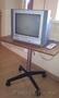 Столик под телевизор на колесиках